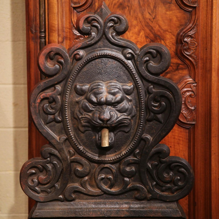 Bring the grand elegance of the Loire Valley into your home with this antique, Gothic iron fountain. Crafted in France, circa 1840, the water fountain features a majestic lion head sculpture, which spits water through a patinated bronze spout and
