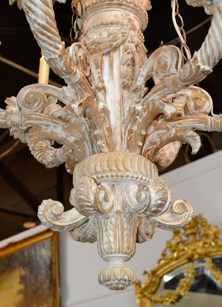Beautiful 19th century French hand carved and white-washed wood 6-light chandelier.