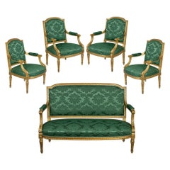19th Century French Carved Giltwood Salon Suite with Settee and 4 Armchairs