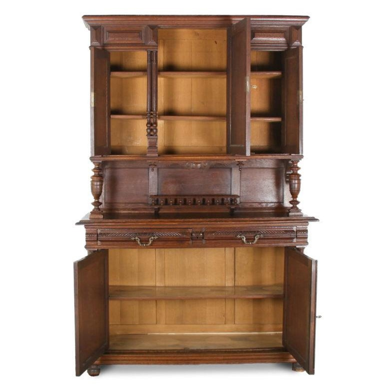 A late 19th century French carved oak 'Henri II' style buffet and hutch. The piece has panelled lower doors below carved gadrooned drawers, the upper section raised on columns and having three doors, the middle one carved with a hunter on