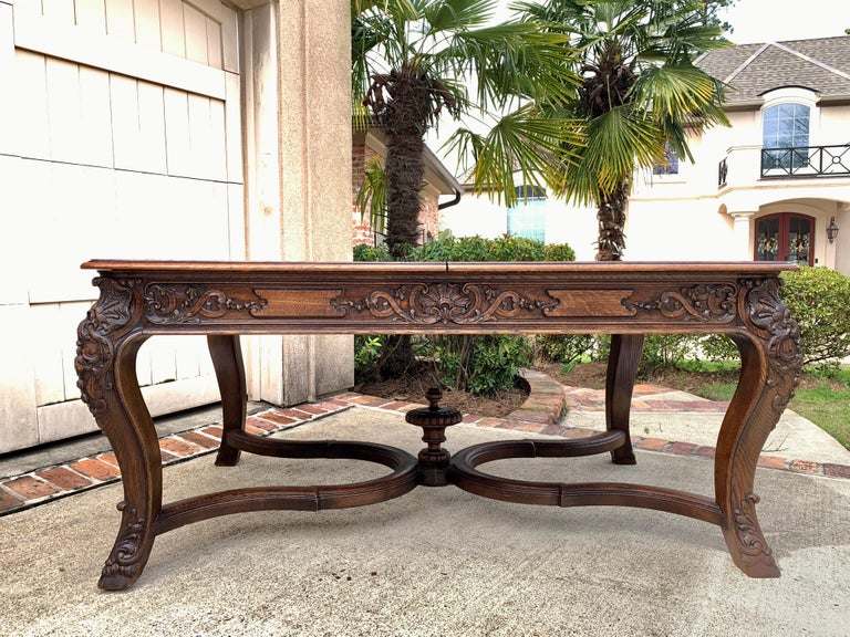 Direct from France, a heavy and substantial antique French carved dining table!~ ~Stunning hand carved details, definitely above average quality, as you can tell with one glance to the massive carvings. The table legs have dimensional French shells