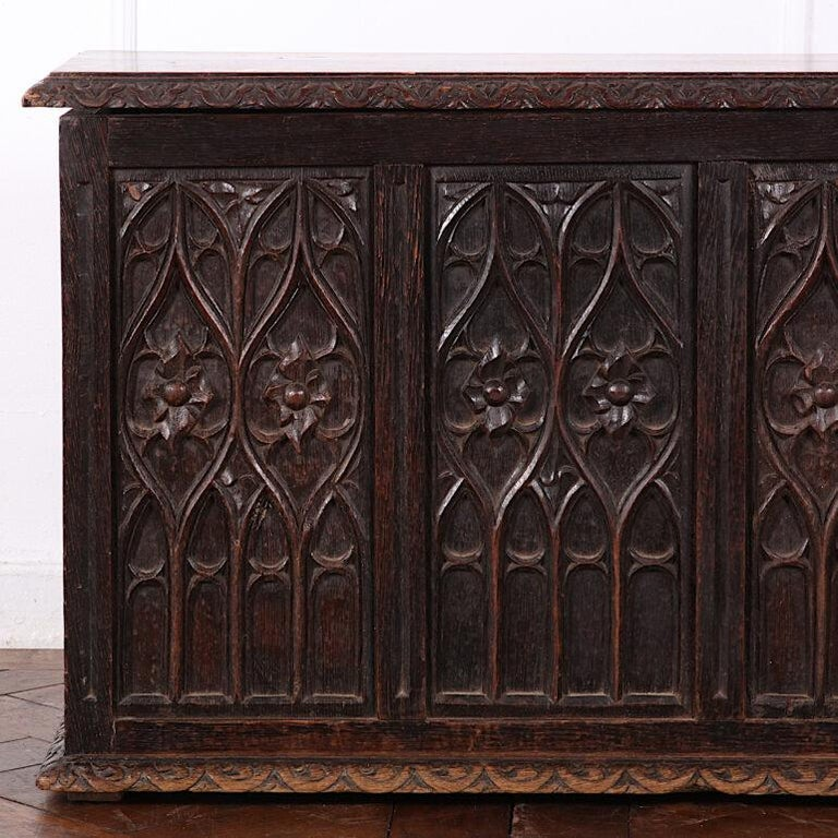 Small French gothic coffer from France the panels with highly-carved gothic arch / tracery details, the hinged top opening to allow storage.