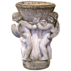 19th Century French Carved Patinated and Weathered Stone Planter with Cherubs
