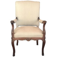 19th Century French Carved Regency Style Walnut Chair with Scrolled Arms