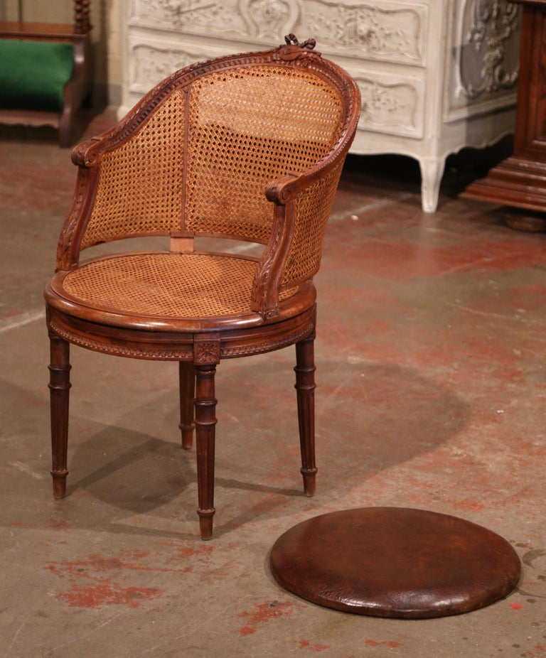 Hand-Carved 19th Century French Carved Walnut and Cane Swivel Desk Armchair with Leather For Sale