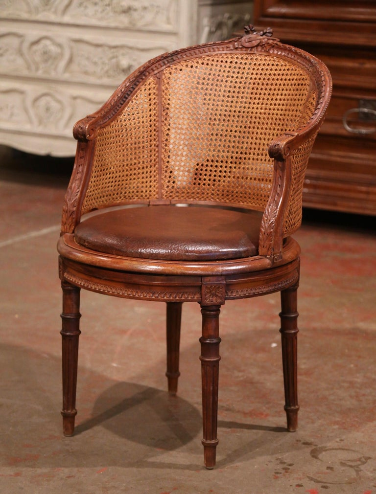19th Century French Carved Walnut and Cane Swivel Desk Armchair with Leather In Excellent Condition For Sale In Dallas, TX