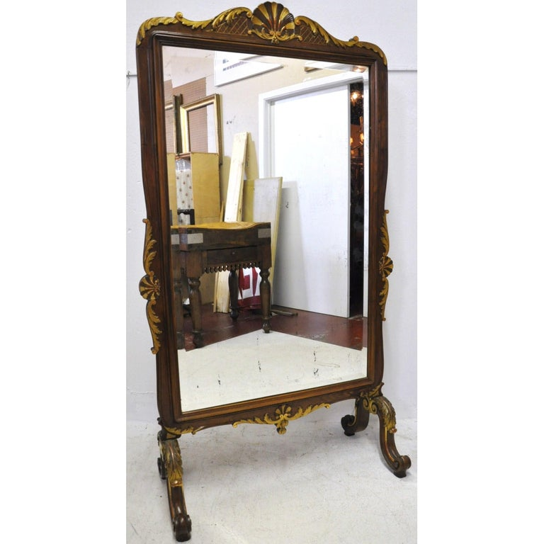 Add elegance and practicality to your walk-in closet or bathroom with this antique floor mirror. Crafted in Lyon, France, circa 1890, the raised mirror is outfitted with beveled mercury glass, and is a beautiful example of the Baroque Louis XV