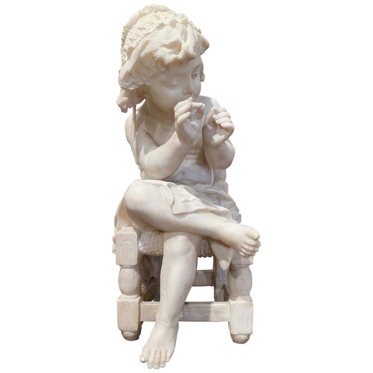 This antique carved marble composition was crafted in France, circa 1870. The sculpture features a child sited on a chair her legs crossed and playing with her fingers. The art work shows exquisite detailed craftsmanship; the chair's construction