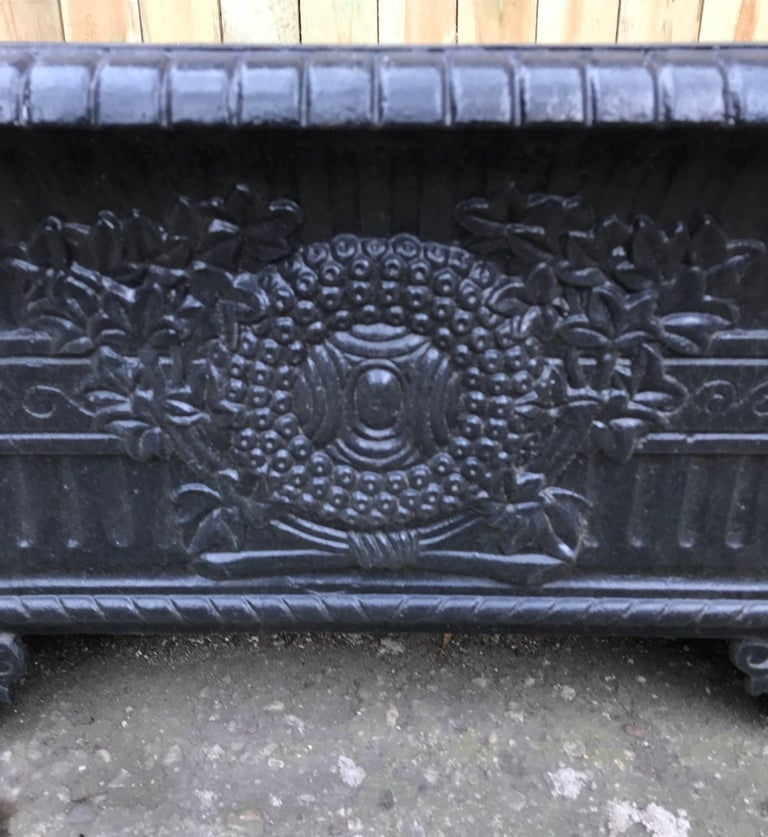 A 19th century French cast iron rectangular planter or jardinière with classical high relief decoration. Supported on splayed Acanthus leaf decorative bracketed feet on each corner. Wonderful decorative garden element.