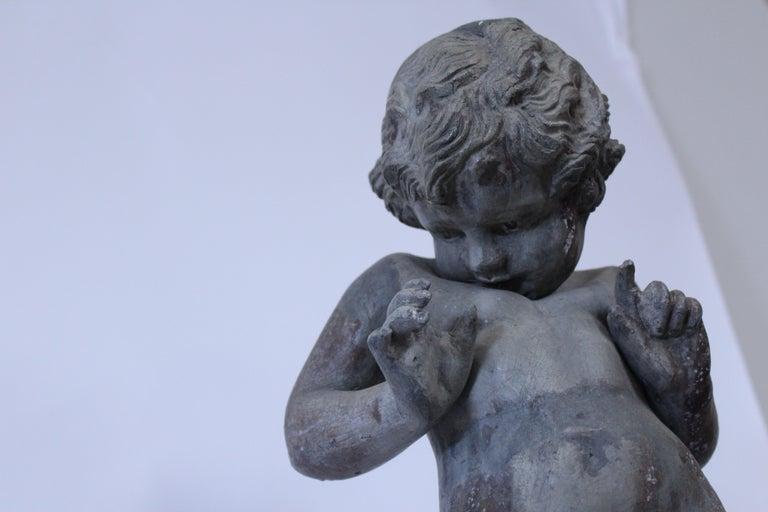 Iron 19th Century French Cast Lead Garden Cherub Statue For Sale