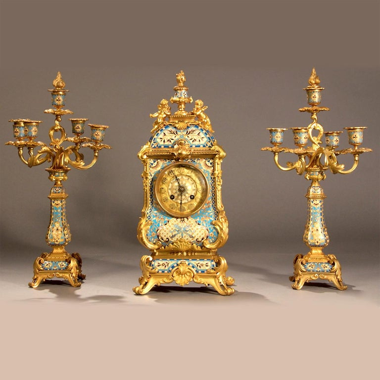 Fine quality and attractive French champleve gilt bronze and light blue champleve enamel clock set. Retailed by Camerden & Forster, New York. Gilt bronze and champleve enamel.   Origin: France  Date: circa 1890 Dimension: Clock: 17 in. x 17 1/2