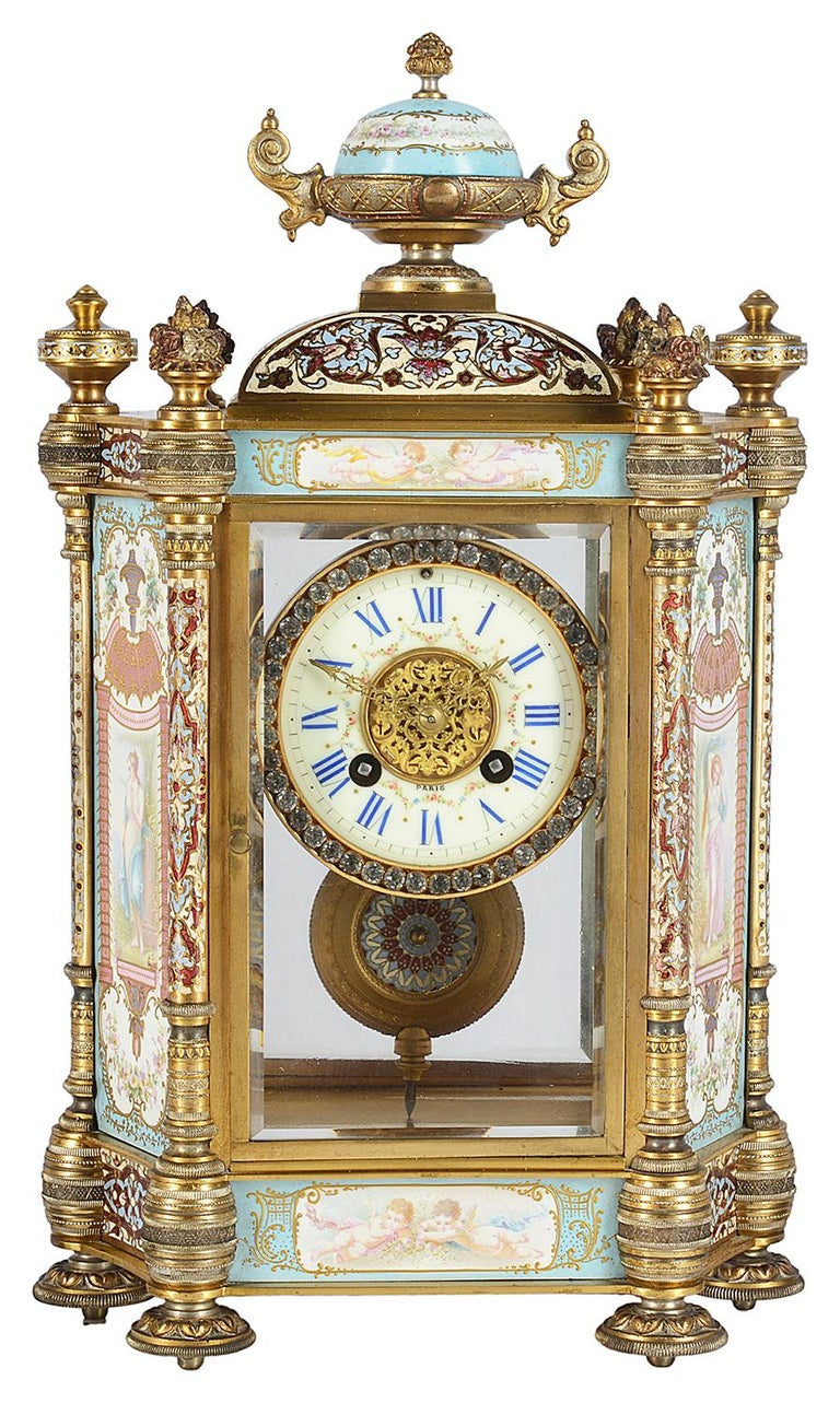 A very good quality late 19th Century French champlevé enamel and porcelain clock garniture, set in a gilded ormolu case, the porcelain panels to the clock and urns depicting classical maidens in the gardens, signed 'Collet', four enamel columns