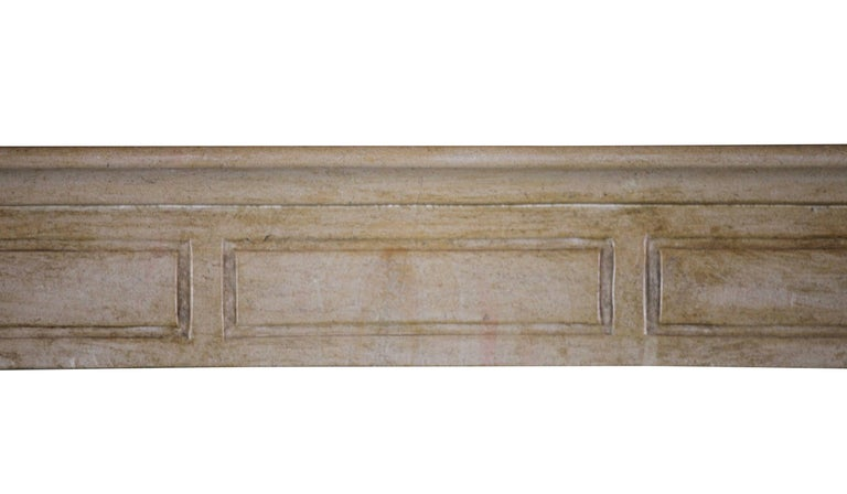 A bicolor burgundy hard stone antique fireplace surround with a round shelf. The jambs are of a deeper color than the front piece. A country look. Measures: 129 cm EW 50.79