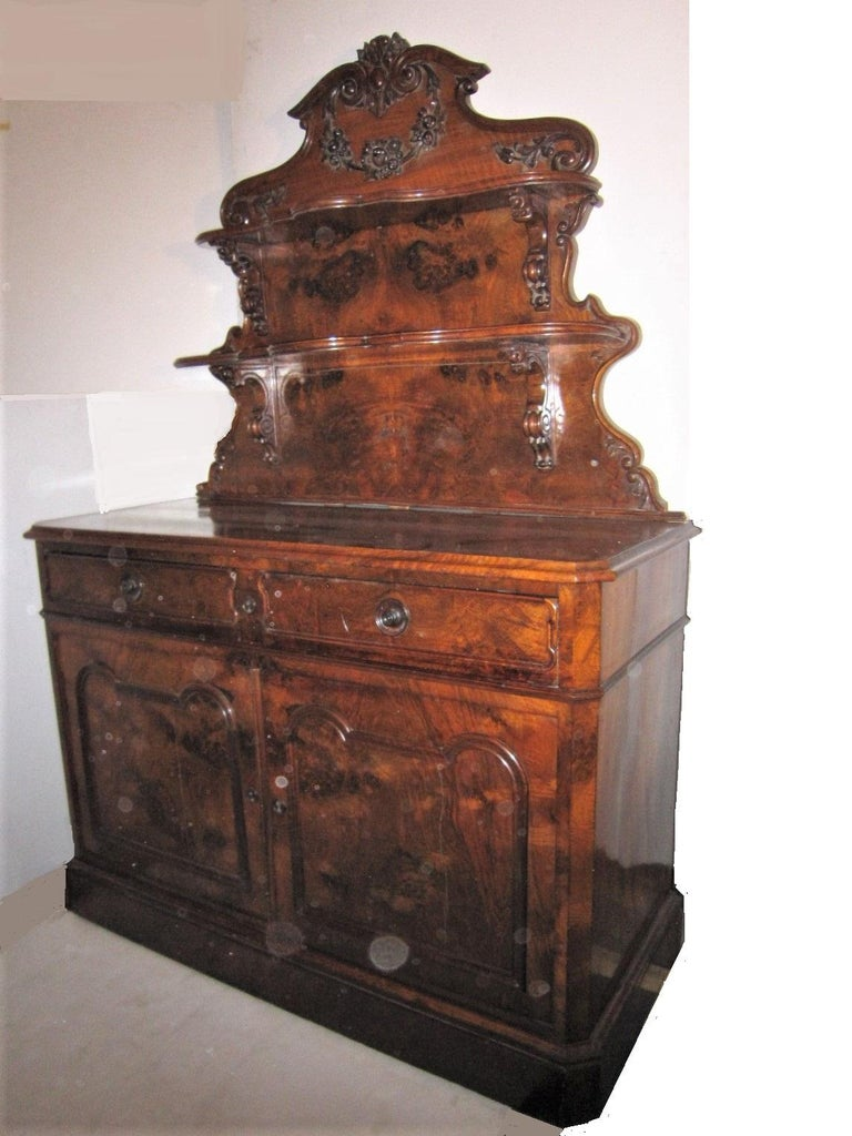 Beautifully hand carved burl walnut, antique country dessert console/ server/ hutch featuring two shelves plus the serving surface with two silverware drawers and double door storage cabinet below. A utilitarian, practical and aesthetic combination