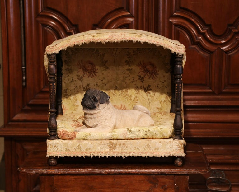 Give your dog or cat a spoiled and lavish lifestyle in this antique dog house. Crafted in France circa 1810, the bed features an arched top and four hand carved turned posts in each corner. The bed has its original removable sleeping cushion and