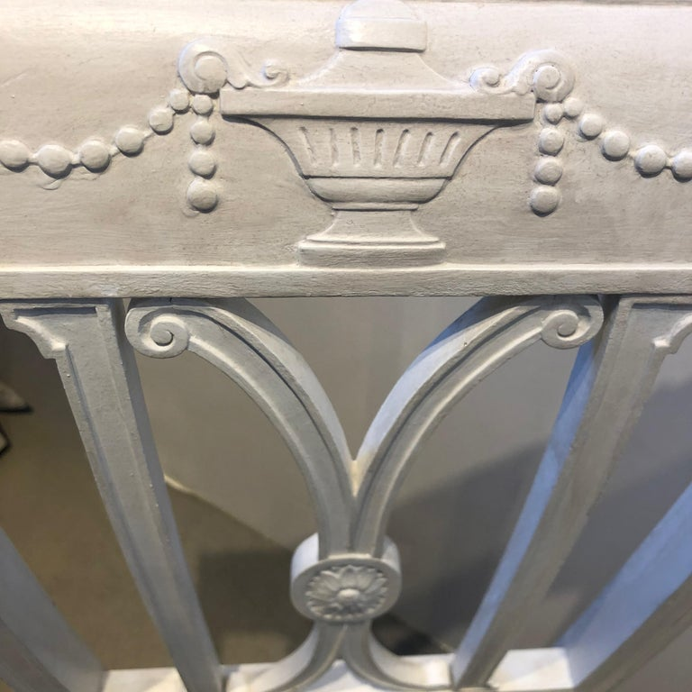 19th century French Directoire white painted wooden chair with black and white striped upholstery.