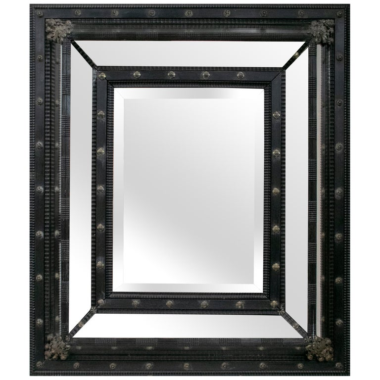 19th Century French Ebonized Mirror with Bronze Decorations For Sale