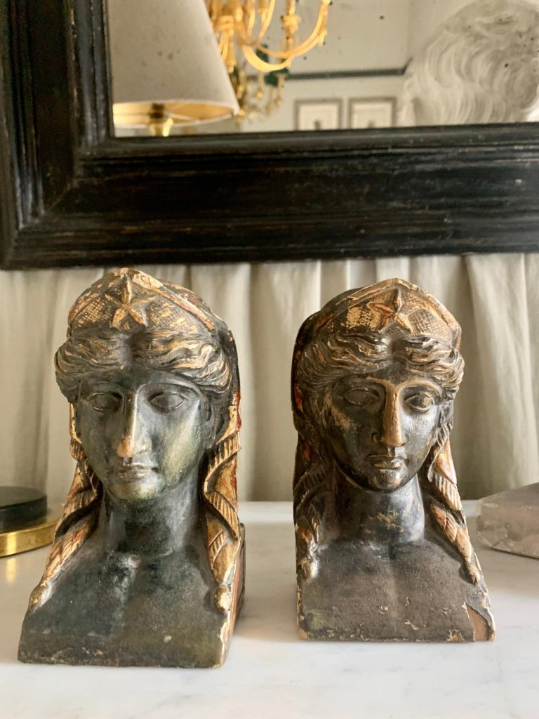 Pair of sphinx heads, French empire era in gilded and polychrome wood, surely they were part of an empire furniture.