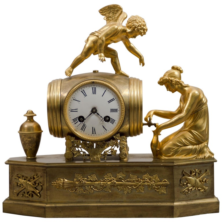 """Early 19th Century French Empire Ormolu Mantel Clock """"Pouring Wine"""" For Sale"""