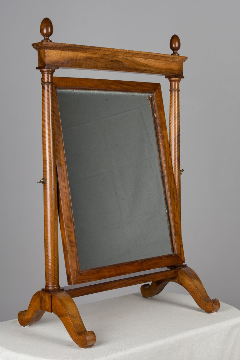 19th century French Empire period cheval, or psyche mirror, made of solid walnut with beautiful wood grain and waxed patina. Nice proportions and large in scale for a tabletop mirror. Turned egg finials, thick mirror with some silvering and light