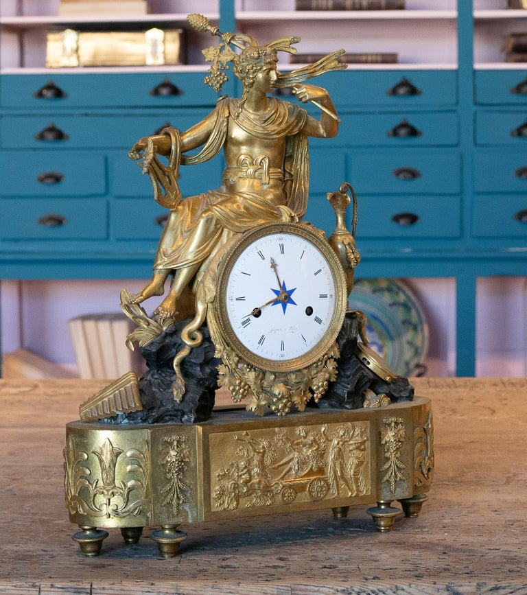 19th century French Empire style gilt bronze mantel (fireplace) clock with the dial inscribed JACQUOT A PARIS.