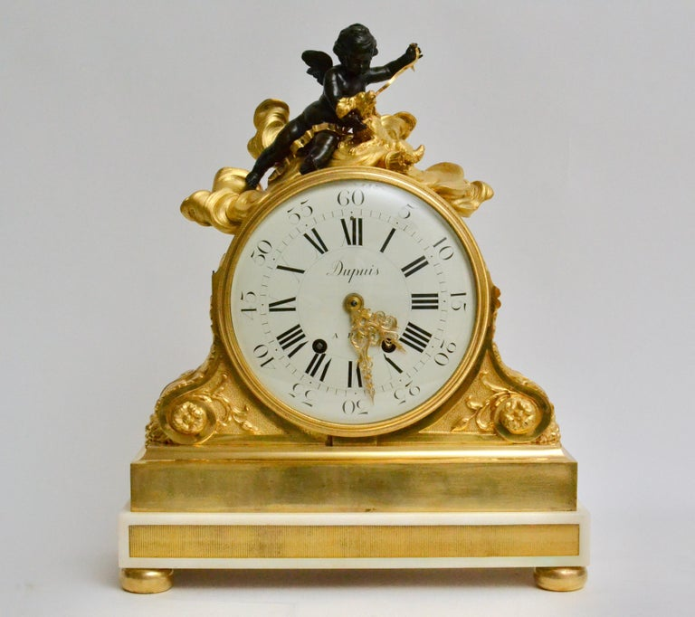 An important and large late 19th century gilt bronze and Carrara marble clock. The gilt bronze and marble clock case signed by Escalier de Cristal, Paris and clockwork by Dupuis a Paris. With inscription: