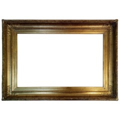 Empire style frame hand carved gilded with pure gold leaf