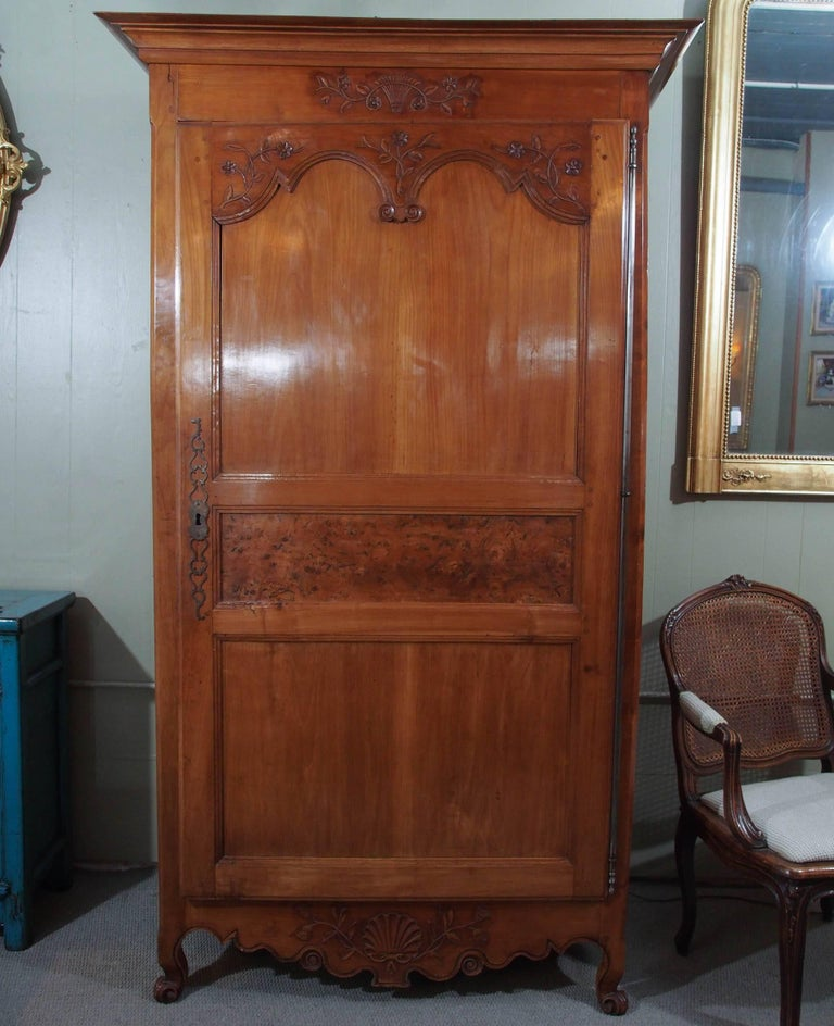Antique French carved fruitwood bonnetierre.