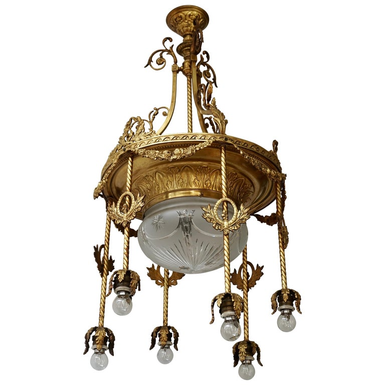 19th Century French Gilt Bronze and Crystal Aesthetic Seven-Light Chandelier For Sale