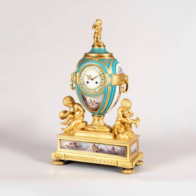 An important Garniture de Cheminée in the manner of Henry Dasson  Constructed in well cast and chased gilt bronze, with 'Sevres' type 'jewelled' gilded porcelain with a Bleu Céleste field, hand painted with polychromes, and comprising a mantle