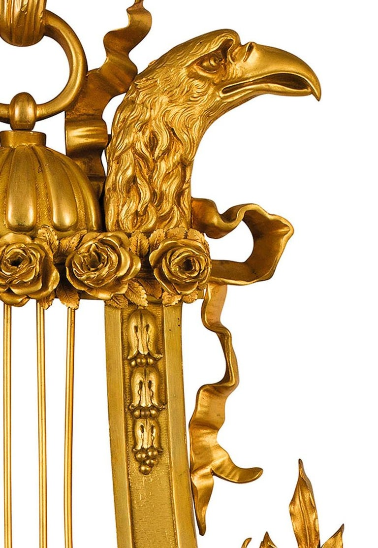 19th century, French gilt bronze Cartel clock  The finely chiseled and gilt bronze Cartel clock was made in France at the end of the 19th century. With the name Cartel are defined those clocks, originally typically French, intended to be hung on