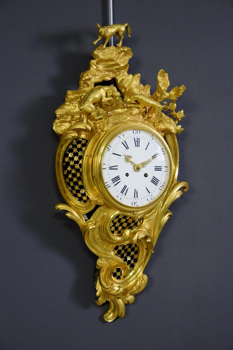 19th century French gilt bronze cartel clock France, mid-19th century  The cartel clock, in chiseled and gilt bronze, with matt and glossy finish, was made in France in the mid-19th century. With the name cartels are defined those clocks,