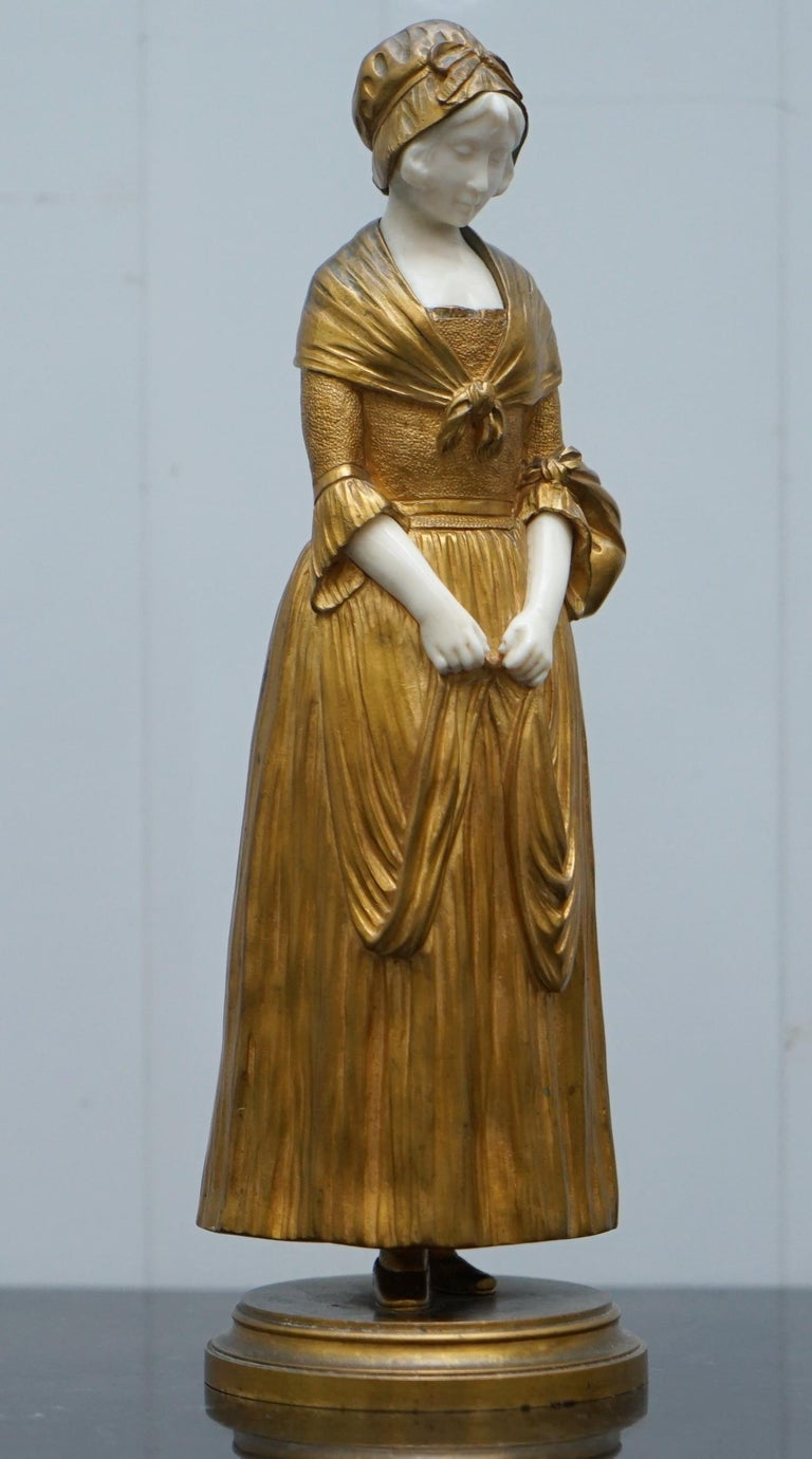 """We are delighted to offer for sale this stunning very rare and highly collectable Dominique Alonzo gilt bronze statue of a young girl titled """"La Vuelta Del Mercado"""" which roughly translates to the """"The Return To The Market""""  I have two of these"""