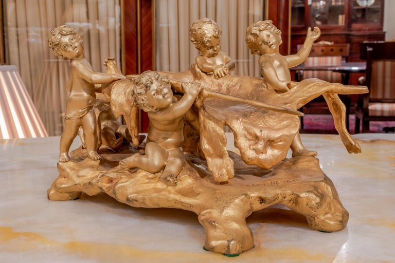 19th century French gilt bronze by August Moreau of a group of cherubs with their kill after the hunt.