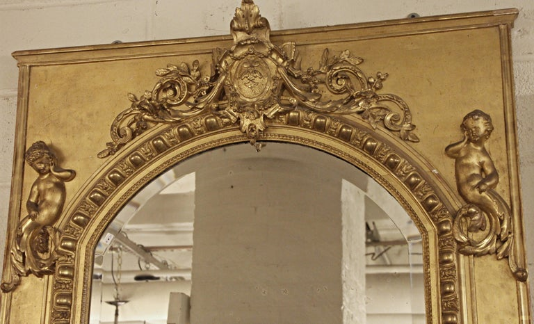 Baroque 19th Century French Gilt Mirror with Cherub and Arched Detail For Sale