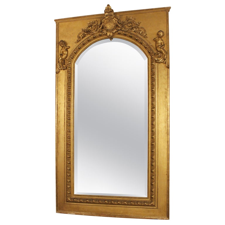 19th Century French Gilt Mirror with Cherub and Arched Detail For Sale