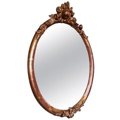 19th Century French Gilt Oval Shaped Mirror with Fruit Ornaments