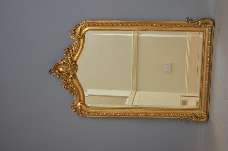 Sn4599 19th century French gilded mirror, having bevelled edge glass in finely decorated giltwood frame. This antique mirror retains its original glass with some foxing, original gilt and original backboards, all in home ready condition, circa