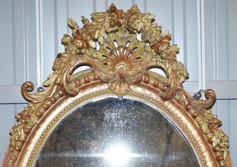 We are delighted to offer for sale this rare 19th century gold giltwood hand carved Gesso wall mirror  A very good looking well made and decorative 19th century French oval mirror, the floral and shell Gesso work is all carved from one solid piece