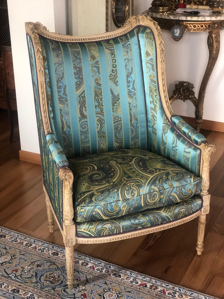 Elegant French hand carved bergere chairs with richly decorated wooden frame hand painted in light grey and brand new upholstery in turquoise silk textile. Very comfortable shape and stable construction. France, circa 1870