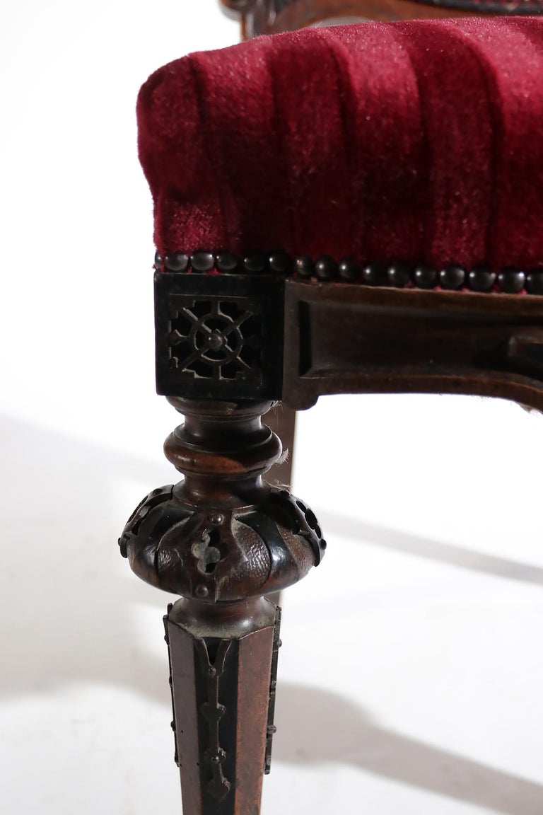 Beautiful chair made in France, circa 1860. Special about the chair are the metal ornaments and the headline contains initials.  The chair is fully new upholstered in red velvet.