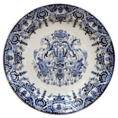 19th Century French Hand Painted Blue and White Faience Charger with Crest Motif