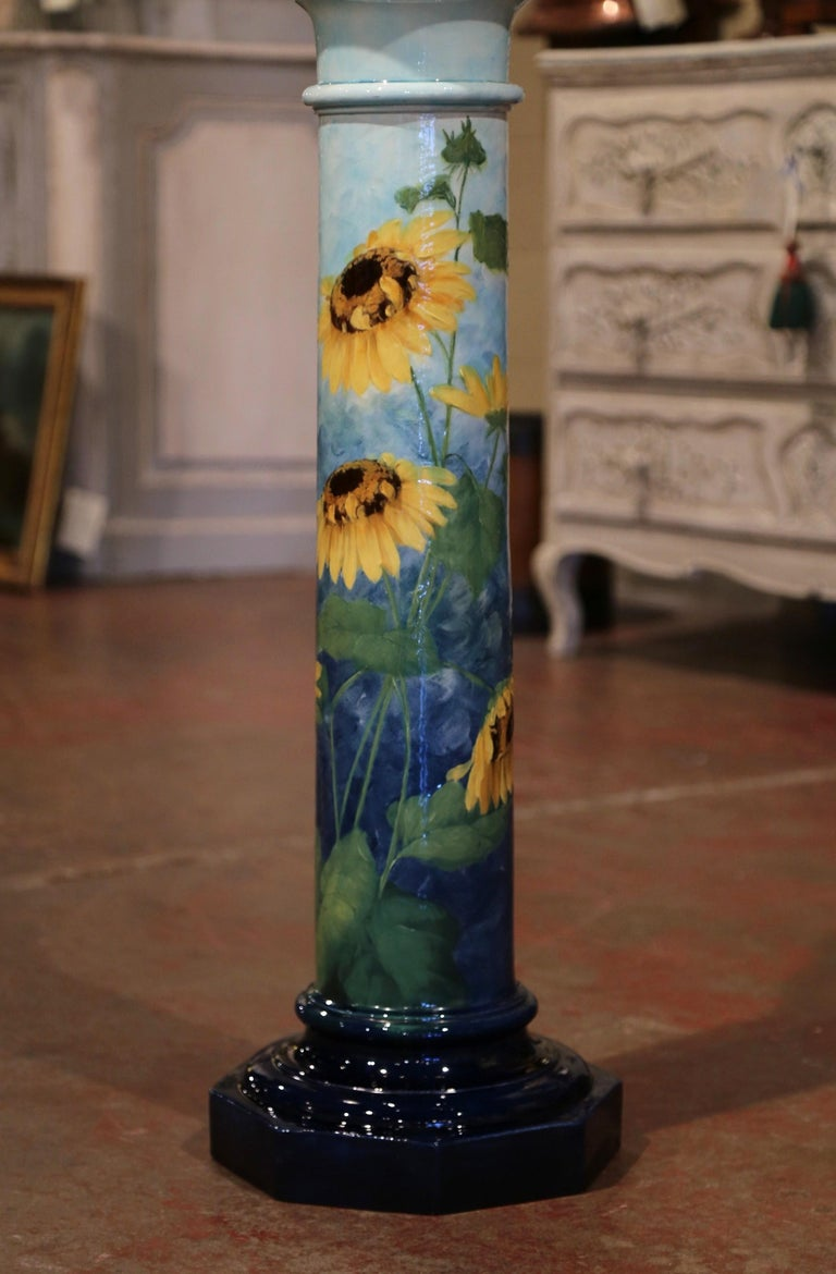 This elegant Majolica cachepot with scalloped edge and matching Stand were created in Southern France by Massier, circa 1890. Round in shape, the antique ceramic planter with scalloped edge is beautifully hand painted with bright yellow Marguerite
