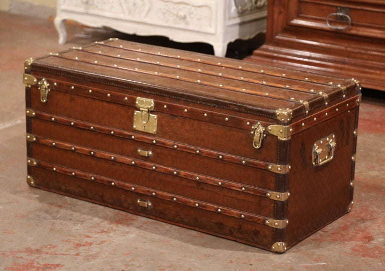 This large trunk would make an elegant coffee or cocktail table! Crafted in Paris circa 1880, the antique trunk is rectangular in shape, and finished on all four sides including the top, it features heavy brass handles with engraving stamp of