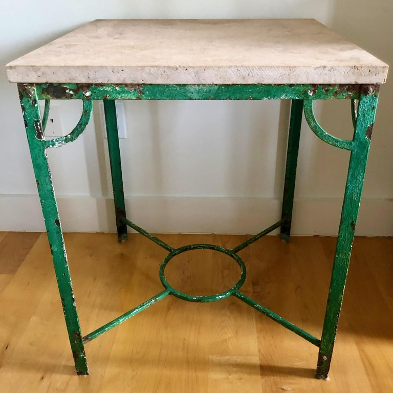 Handsome French iron table with stone top in original bright green patina.
