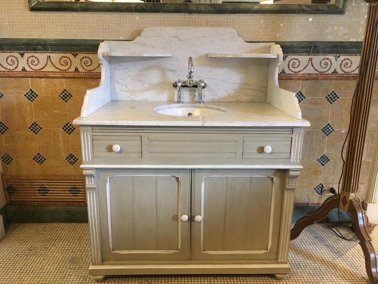 19th century French lacquered cupboard sink with Carrara marble top, 1890s.