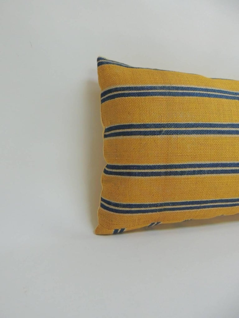 19th century French linen stripes in shades of blue and yellow on antique textile linen. Long bolster throw pillow finished with quilted yellow cotton backing.