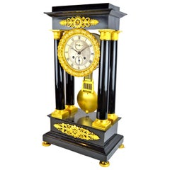 19th Century French Louis Philippe Ebonized Wood and Gilt Bronze Portico Clock