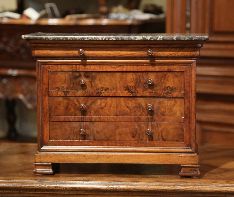 Decorate a master bathroom counter with this miniature chest of drawers. Crafted in France circa 1890, the petite fruit wood