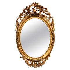 19th Century French Louis XV Carved Giltwood Oval Wall Mirror